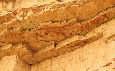 Triangle motifs were even found on this high rock overhang, at Walt's Canyon near Carlsbad, where coyote tobacco again was found. (Courtesy L. Loendorf)