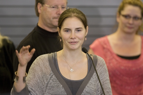 Amanda Knox waves to supporters as she makes her first appearance at SeaTac Airport after arriving in Seattle following her release from prison in Italy on October 4, 2011. US student Amanda Knox arrived home a day after she was acquitted of murder and sexual assault charges and freed from jail in Italy, after a four-year ordeal.