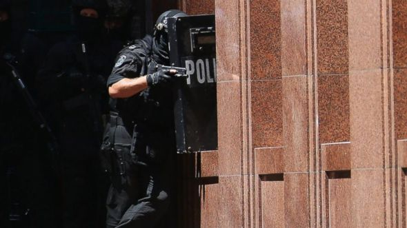 Armed police patrol the vicinity at Lindt Cafe, Martin Place on Dec. 15, 2014 in Sydney, Australia. Don Arnold/Getty Images