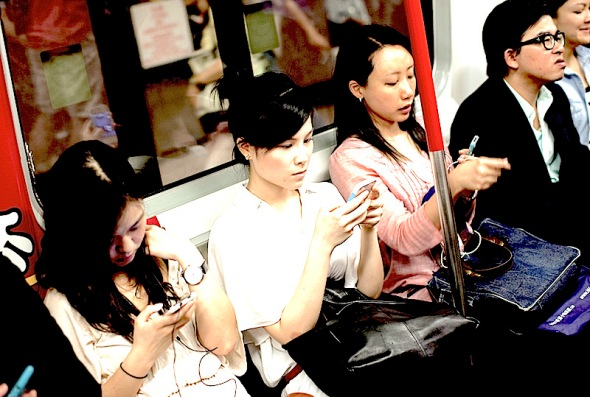 Commuters use smartphone