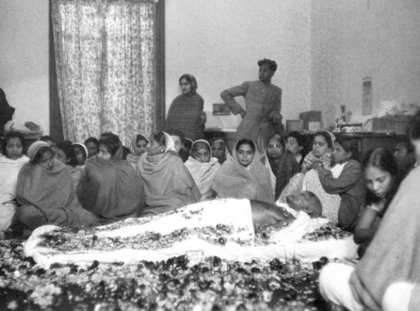 Mahatma Gandhi, lying in state, after his assassinatino in 1948. Photo via Wikimedia Commons.