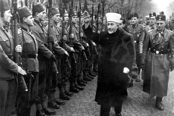 The grand mufti of Jerusalem, Hajj Amin al-Husayni, inspects Bosnian SS members in 1944. PHOTO: ALAMY