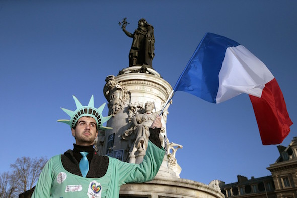 A man dressed as the Statue of Liberty holds up the French national flag at the Place de la République. JOEL SAGET/AGENCE FRANCE-PRESSE/GETTY IMAGES