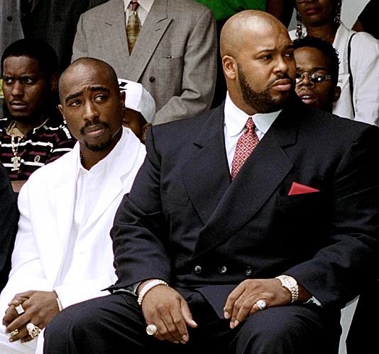 Tupac Shakur, left, and Suge Knight, one month before Shakur's 1996 death. (Frank Wiese/AP file)