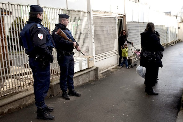 Policemen guard a Jewish school in Sarcelles, France, Thursday. Agnes Dherbeys for The Wall Street Journal