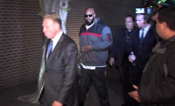 This image from video shows Suge Knight arriving at the Los Angeles County Sheriff's Department West Hollywood station. (OnSceneVideo via AP Television)