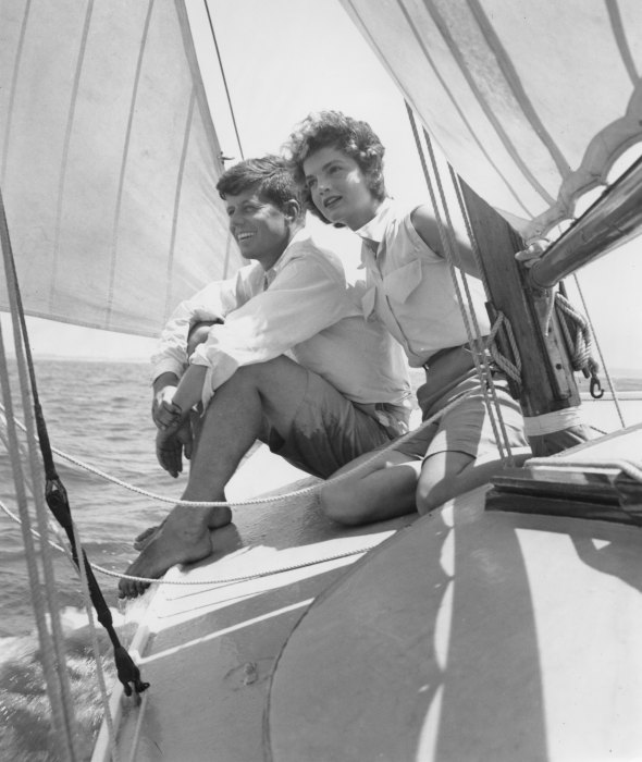 HYANNIS PORT, MA  - JUNE 1953:  Senator John F. Kennedy and fiance Jacqueline Bouvier go sailing while on vacation at the Kennedy compound in June 1953 in Hyannis Port, Massachusetts. (Photo by Hy Peskin/Getty Images)