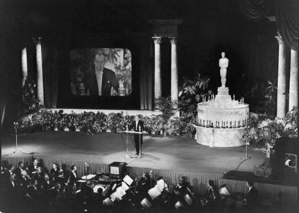 British-born American entertainer Bob Hope (1903 - 2003) speaks from behind a podium at the RKO Pantages theater as he hosts the 25th Annual Academy Awards, the first televised presentation of the annual award ceremony, Hollywood, California, March 19, 1953. (Photo by J. R. Eyerman/The LIFE Picture Collection/Getty Images)