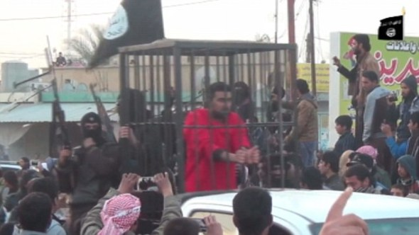 ISIS parades 'Kurdish Peshmerga' fighters in cages before mob