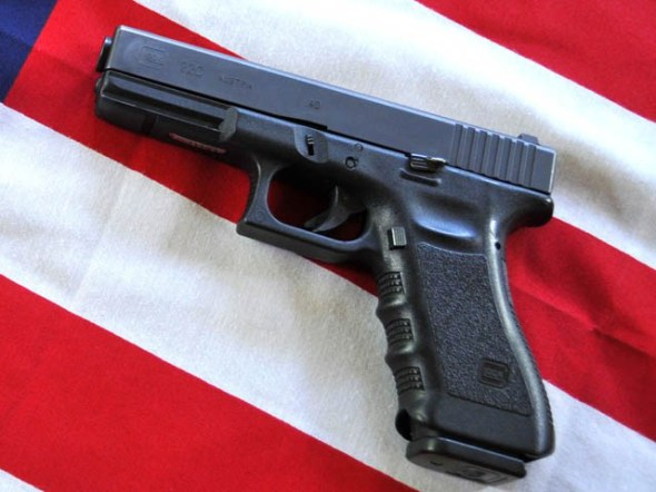 A Glock .40 caliber handgun is displayed