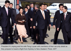 In this photo, we see Xi's bodyguards in Western suit