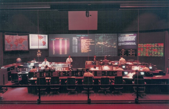 From their key positions in this control center at Goddard, the Manned Space Flight Network operations director and staff controlled Apollo mission communications activities throughout a far-flung worldwide complex of stations. Image Credit: NASA's Goddard Space Flight Center.