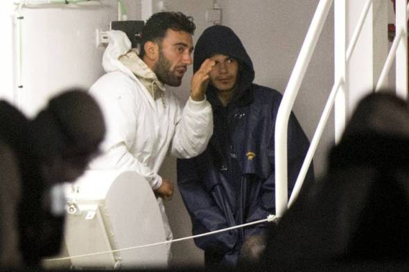 The migrant boat's captain, Mohammed Ali Malek, left, and Mahmud Bikhit, two of the survivors of the boat that overturned off the coast of Libya, are being detained by Italian police. Photo: Alessandra Tarantino/Associated Press