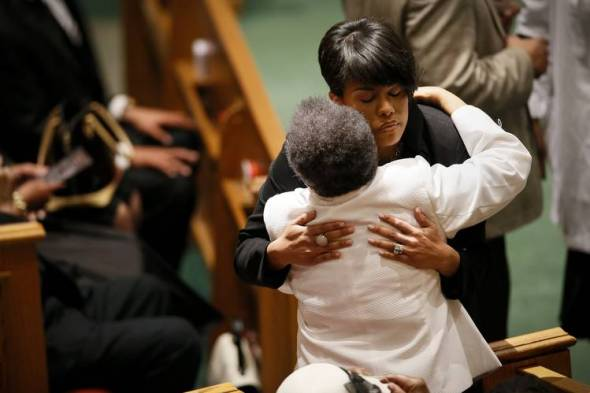Baltimore Mayor Stephanie Rawlings-Blake hugs a member of the Gray family during Freddie Gray's funeral. Photo: Shawn Hubbard for The Wall Street Journal