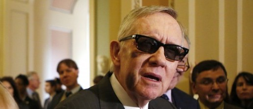 Senate Minority Leader Harry Reid (D-NV) (R) talks to the media, after a weekly Senate party caucus luncheon on Capitol Hill in Washington, Feb. 24, 2015. (REUTERS/Yuri Gripas)