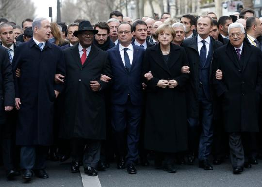 French President François Hollande, center, is surrounded by heads of state including, from left, Israeli Prime Minister Benjamin Netanyahu, Malian President Ibrahim Boubacar Keïta, German Chancellor Angela Merkel, European Council President Donald Tusk and Palestinian President Mahmoud Abbas as they attend the solidarity march in the streets of Paris. (Photo: Philippe Wojazer/Reuters)