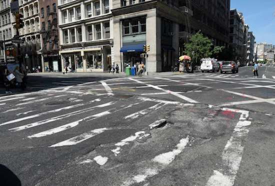 For Sunday News: 05/14/15:Potholes: New York - Easterly crosswalk at Broome St. and Broadway where street is full of cracks and holes.  Dominique Sharpton filed a lawsuit against the city for injuries related to falling there and city's failure to fix the street.   Photo by Helayne Seidman