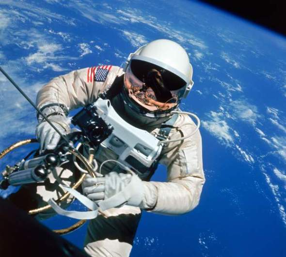 Astronaut Ed White making first American space walk, 120 miles above the Pacific Ocean.