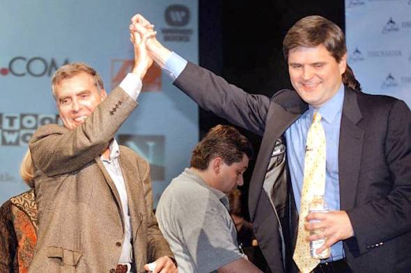 Time Warner CEO Gerald Levin, left, and America Online CEO Steve Case give a high-five after announcing that AOL was acquiring Time Warner in 2000. Photo: Chris Hondros/Newsmakers/Getty Images