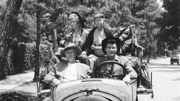 "FILE - This 1967 file photo shows, cast members, front, from left, Buddy Ebsen and Max Baer, and rear, from left, Donna Douglas and Irene Ryan, of the television series ""The Beverly Hillbillies."" Douglas, who played the buxom tomboy Elly May Clampett on the hit 1960s sitcom has died. Douglas, who was 82, died Thursday, Jan. 1, 2015, in Baton Rouge, where she lived, her niece, Charlene Smith, said. (AP Photo, File)"