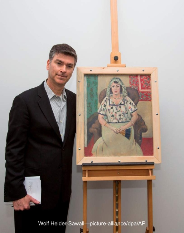 HANDOUT - A handout picture provided by Wolf Heider-Sawall/Art Recovery Group/dpa shows the representative of the Rosenberg family, Christopher Marinello, who receives the painting 'Seated Woman' by Henri Matisse on behalf of the family in Munich, Germany, 15 May 2015. The painting is one of the most famous works of the controversial art collection of Cornelius Gurlitt. (ATTENTION: Editorial use only. Mandatory credit: Wolf Heider-Sawall/Art Recovery Group/dpa) Photo by: Wolf Heider-Sawall/picture-alliance/dpa/AP Images