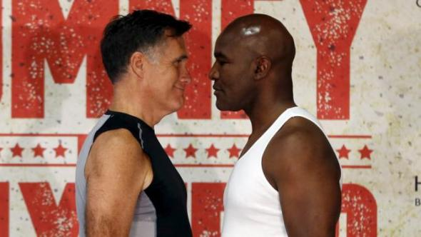 Former Massachusetts Governor and two-time presidential candidate Mitt Romney (L) and five-time heavyweight champion Evander Holyfield stare down during their weigh-in before their boxing match in Holladay, Utah May 14, 2015. The two will box on Friday to benefit the medical charity CharityVision. REUTERS/Jim Urquhart      TPX IMAGES OF THE DAY