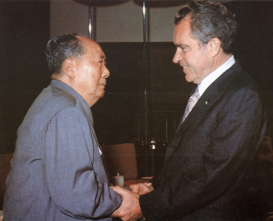 Chairman Mao Tse-tung, left, welcomes US President Richard Nixon at his house in Beijing (AFP)