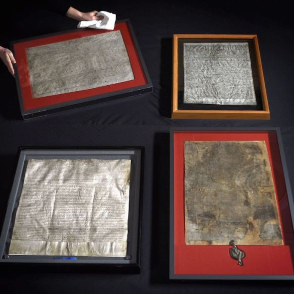United for the first time, the four surviving original Magna Carta manuscripts are prepared for display at the British Library, London, Feb. 1, 2015. Photo: UPPA/ZUMA PRESS