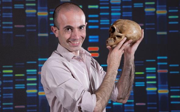 Yuval Noah Harari holds a homo sapiens skull