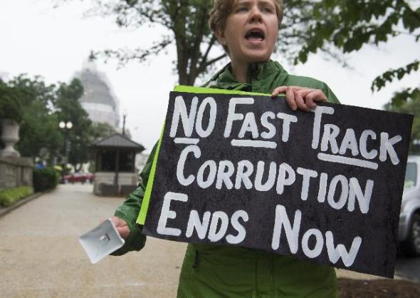 A demonstrator protests against the legislation to give US President Barack Obama fast-track authority to advance trade deals (Credit: Saul Loeb/AFP/Getty Images)