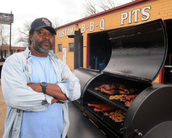 The Houston Rodeo Barbecue Grand Champion Kerry Fellows with the pit he used from Pitts by JJ on the Eastex Freeway Saturday March 09, 2013.(Dave Rossman/ For the Chronicle)