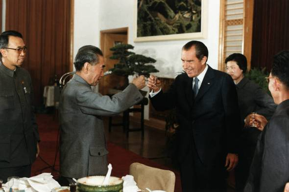 President Richard Nixon, right, toasts Chinese Prime Minister and Foreign Minister Zhou Enlai during a banquet in Hangzhou, China, on Feb. 27, 1972.Photo: CORBIS