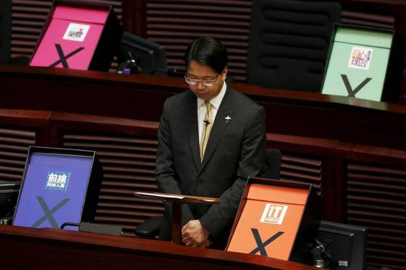 Pro-democracy lawmaker Charles Mok is surrounded by veto signs during his speech in Hong Kong's legislature on Thursday. Photo: Reuters