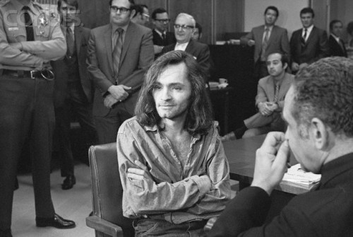 "19 Jun 1970, Santa Monica, California, USA --- ""I Don't Have Any Guilt"" said long-haired hippie chieftain Charles Manson, 35, in brief press conference in courtroom here, June 18, where a hearing to continue proceedings in the murder case of musician Dary Hinman was held.  Manson's trial for the slaying of actress Sharon Tate and four others last August 9th, and the killing of a wealthy supermarket chain owner and his wife the day after the Tate murder, began this week and forced postponement of the Hinman case. --- Image by © Bettmann/CORBIS"