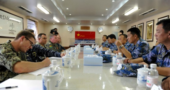 U.S. Navy leadership and senior officers from the Chinese People's Liberation Army (Navy) meet for lunch aboard the Chinese destroyer Harbin (DDG 112) marking the conclusion of a U.S.-China counter piracy exercise between Harbin and the guided-missile destroyer USS Mason (DDG 87). Mason is deployed in support of maritime security operations and theater security cooperation efforts in the U.S. 5th Fleet area of responsibility. (U.S. Navy photo by Mass Communication Specialist 1st Class Gary M. Keen/Released)