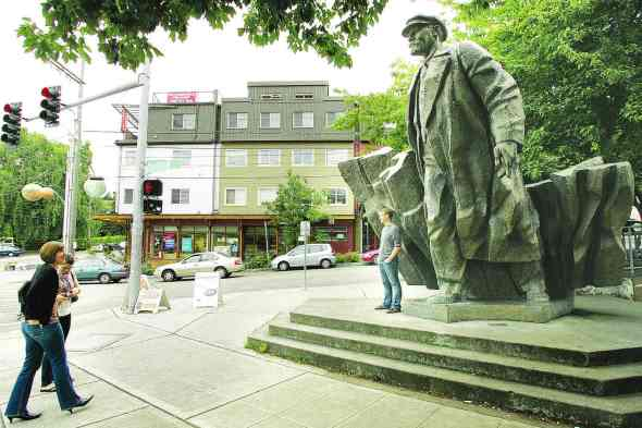 By Greg Farrar Friends out on a walk in Fremont take a smartphone picture of one of them standing before the 16-foot tall Lenin statue brought to America by late Issaquah resident Lewis Carpenter.