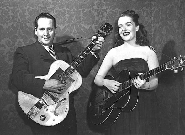 Les Paul and his wife, Mary Ford, perform with their guitars. Paul, 94, the guitarist and inventor who changed the course of music with the electric guitar and multitrack recording and had a string of hits, died, Thursday, Aug. 13, 2009 in White Plains, N.Y., according to Gibson Guitar. (AP Photo, file)