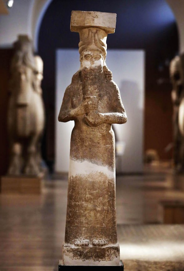 FILE- In this file photo taken on Monday, Sept. 15, 2014 photo shows, a calcareous stone statue displayed at the Iraqi National Museum in Baghdad.  The videos of Islamic State militants destroying the ancient artifacts in Iraq's museums and blowing up temples and palaces are chilling enough, but one of Iraq's top antiquities officials said it is all a cover for an even more sinister activity _ the wholesale looting and selling of the country's cultural heritage. (AP Photo/Hadi Mizban, File)