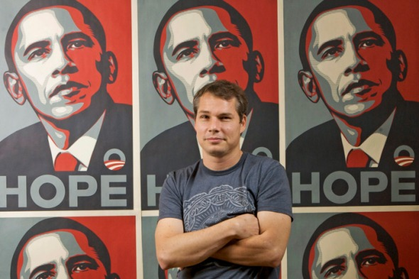 FILE - In this Jan. 12, 2009 file photo, Los Angeles street artist Shepard Fairey poses in front of the Barack Obama Hope artwork he designed in the Echo Park area of Los Angeles. Fairey was sentenced in Manhattan Federal court in New York, Friday, Sept. 7, 2012, to two years of probation and 300 hours of community service for destroying and fabricating documents in a civil lawsuit pertaining to The Associated Press photograph he relied upon to make the poster. (AP Photo/Damian Dovarganes, File)