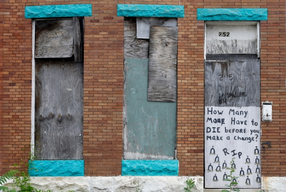 This July 30, 2015 picture shows a blighted home in west Baltimore. Murders are spiking again in Baltimore, three months after Freddie Gray's death in police custody sparked riots. This year's monthly bloodshed has twice reached levels unseen in a quarter-century. In May, Baltimore set a 25-year high of 42 recorded killings. After a brief dip in June, the homicide is soaring again. (AP Photo/Patrick Semansky)