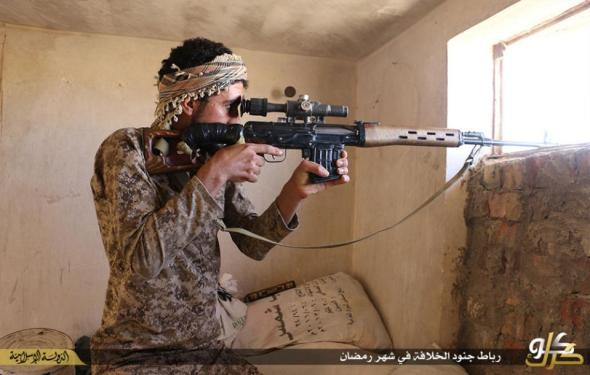 In this photo released on June 23, 2015 by a website of Islamic State militants, an Islamic State militant looks through the scope of his rifle in Kirkuk, northern Iraq. Though best known for its horrific brutalities _ from its grotesque killings of captives to enslavement of women _ the Islamic State group has proved to be a highly organized and flexible fighting force, according to senior Iraqi military and intelligence officials and Syrian Kurdish commanders on the front lines. (Militant website via AP)