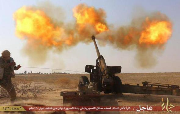 "In this photo released on June 23, 2015 by a website of Islamic State militants, an Islamic State militant fires artillery against Syrian government forces in Hama city, Syria. Special troops called ""Inghemasiyoun,"" Arabic for ""those who immerse themselves,"" are possibly the deadliest weapon in the extremist group's arsenal: Fanatical and disciplined, they infiltrate their targets, unleash mayhem and fight to the death. (Militant website via AP)"