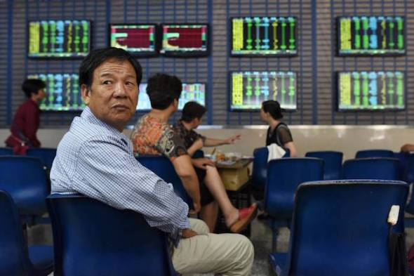 An investor at a brokerage firm in the Chinese city of Heifi on Wednesday. Individual investors who began selling in mid-June helped unleash a downward spiral of more selling. Photo: Reuters