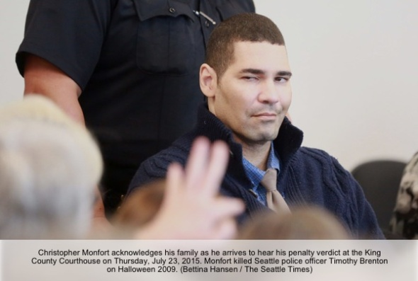Christopher Monfort acknowledges his family as he arrives to hear his penalty verdict at the King County Courthouse Thursday July 23, 2015. Monfort killed Seattle police officer Timothy Brenton on Halloween, 2009.  (Bettina Hansen / The Seattle Times)