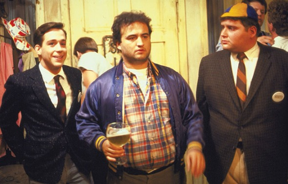 Belushi (center) in 1978's Animal House, scripted by Ramis, Doug Kenney and Chris Miller.