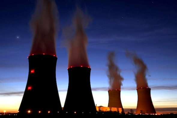 "Steam rises at night from the cooling towers of the Electricite de France (EDF) nuclear power station in Dampierre-en-Burly, France in this March 8, 2015 file photo. French power utility EDF is expected to hold its AGM this week.   REUTERS/Christian Hartmann/Files   GLOBAL BUSINESS WEEK AHEAD PACKAGE - SEARCH ""BUSINESS WEEK AHEAD MAY 18"" FOR ALL IMAGES"