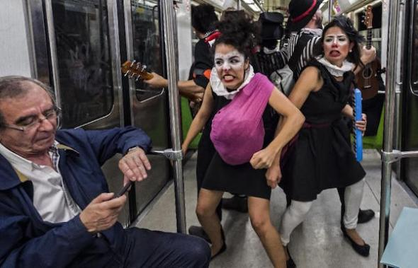 """Six philosophy graduates founded the group """"Ponte la del Metro"""" to restore metro etiquette in 2010, and later created Claustrofobos (AFP Photo/Omar Torres)"""
