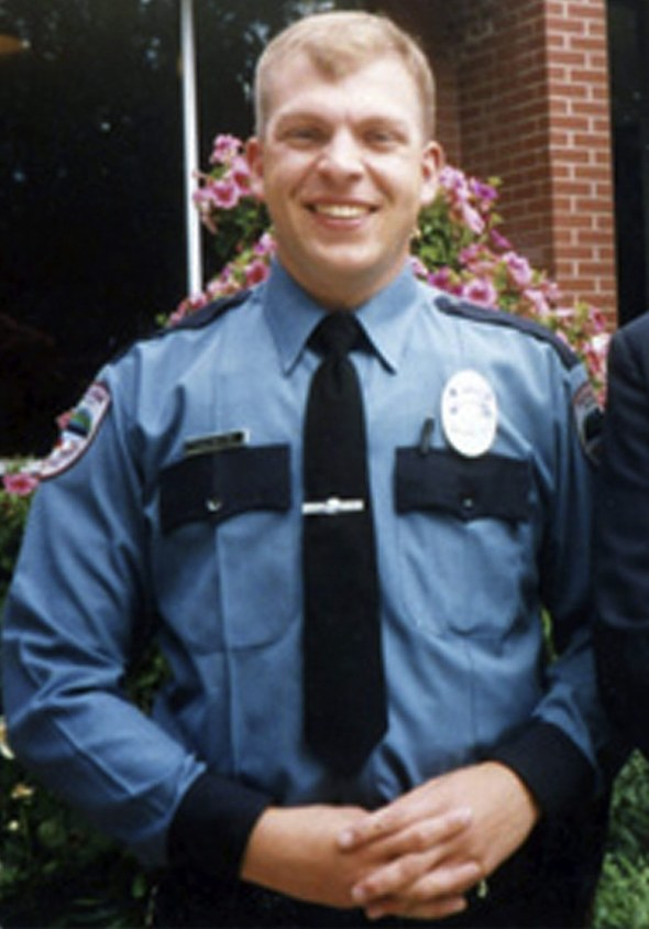 In this undated family photo provided by the Seattle Police Dept., shows Seattle police officer Timothy Brenton.  Brenton was killed in a Halloween night drive-by shooting that also grazed a rookie officer. The 39-year-old training officer from Marysville was hit in the head as he sat in a car reviewing a traffic stop with officer Britt Sweeney. Brenton's memorial service is set for Friday at Seattle's Key Arena.  (AP Photo/ family photo provided by the Seattle Police Dept.) NO SALES SE101  ( / The Associated Press)