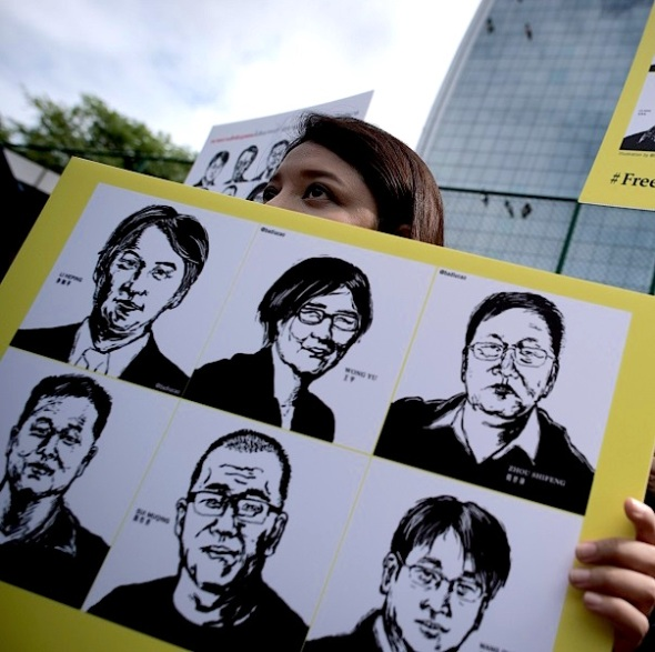 Activists protest outside the Chinese embassy in Bangkok on August 6, 2015. Amnesty International staged a protest outside the Chinese embassy to demand the release of over 200 human rights lawyers and activists in China. AFP PHOTO / Nicolas ASFOURI