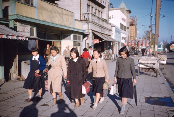 Schoolgirls on a street, Japan, ca. 1949-51